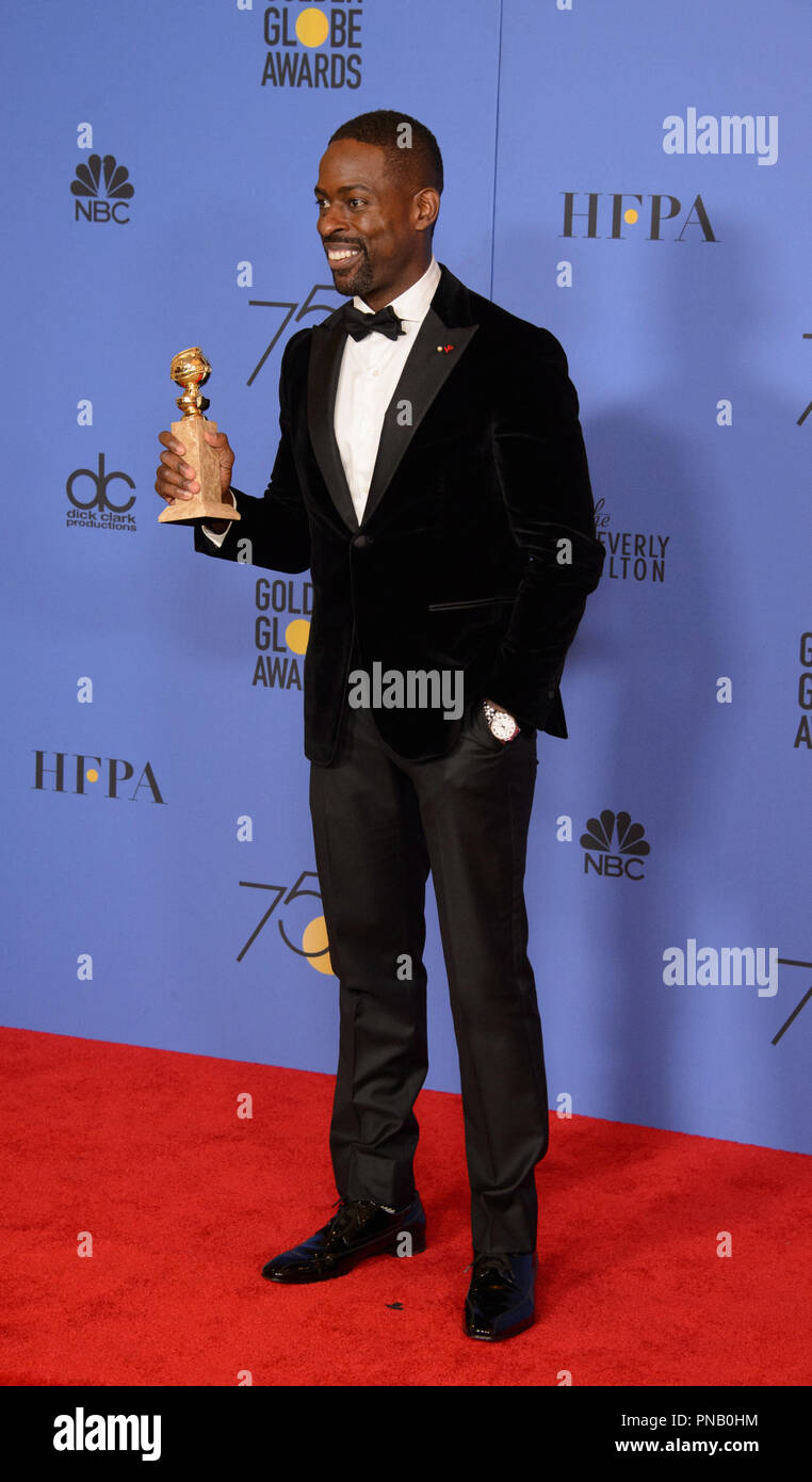 """After winning the category of BEST PERFORMANCE BY AN ACTOR IN A TELEVISION SERIES – DRAMA for his role in """"This Is Us,"""" actor Sterling K. Brown poses backstage in the press room with his Golden Globe Award at the 75th Annual Golden Globe Awards at the Beverly Hilton in Beverly Hills, CA on Sunday, January 7, 2018. Stock Photo"""