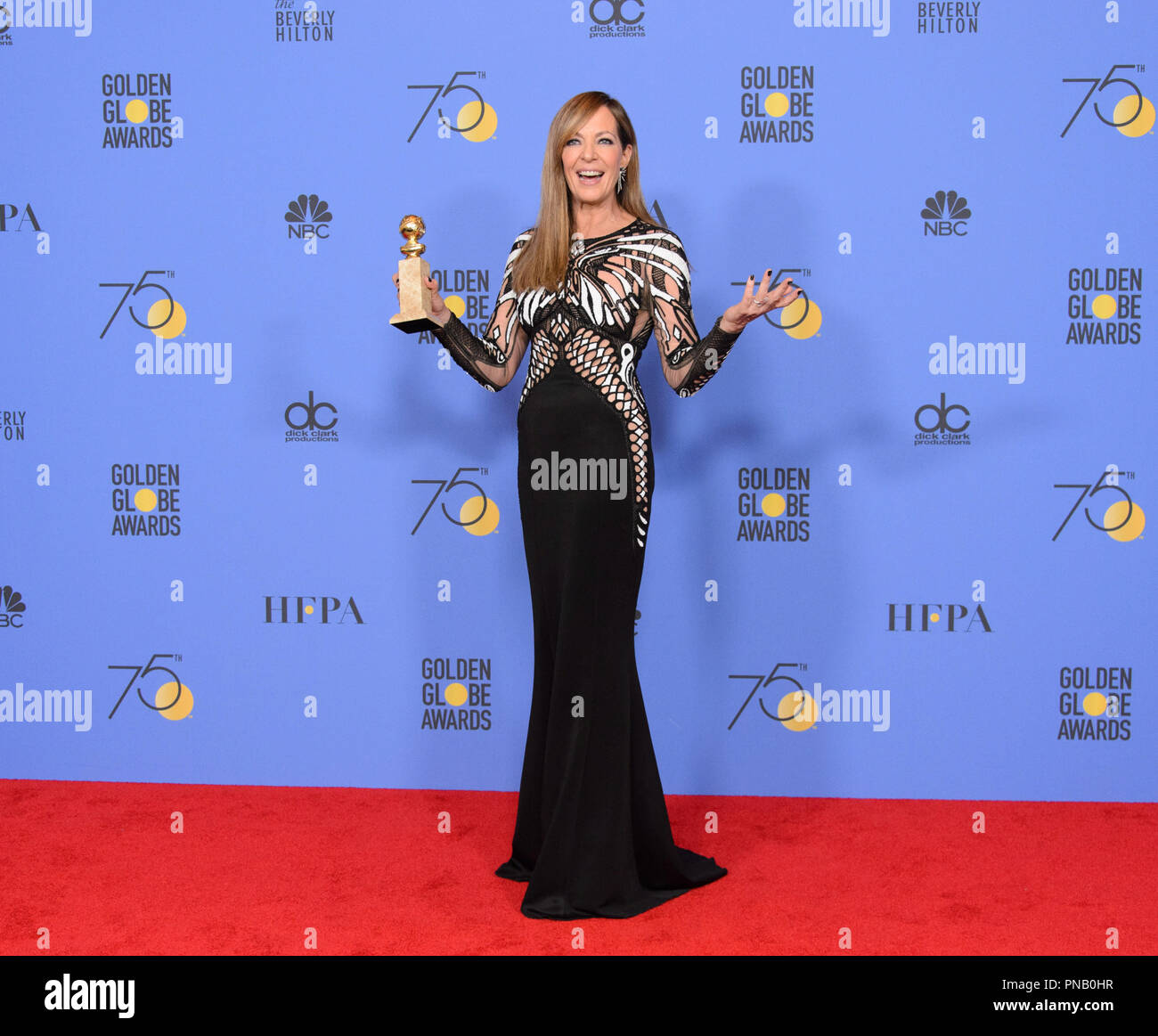 """After winning the category of BEST PERFORMANCE BY AN ACTRESS IN A SUPPORTING ROLE IN A MOTION PICTURE for her work in """"I, Tonya,"""" actress Allison Janney poses backstage in the press room with her Golden Globe Award at the 75th Annual Golden Globe Awards at the Beverly Hilton in Beverly Hills, CA on Sunday, January 7, 2018. Stock Photo"""