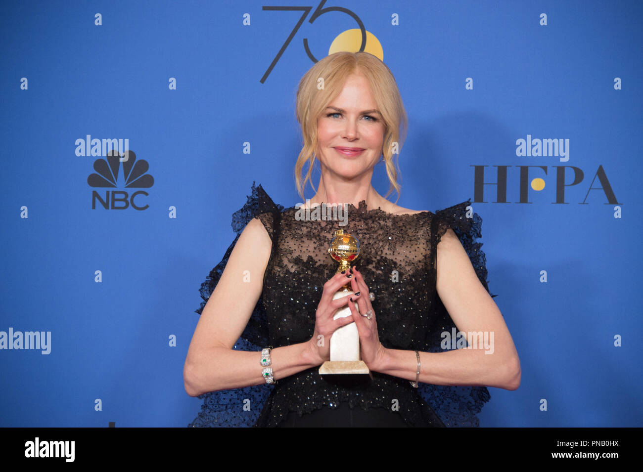 """After winning the category of BEST PERFORMANCE BY AN ACTRESS IN A LIMITED SERIES OR A MOTION PICTURE MADE FOR TELEVISION for her role in """"Big Little Lies,"""" actress Nicole Kidman poses backstage in the press room with her Golden Globe Award at the 75th Annual Golden Globe Awards at the Beverly Hilton in Beverly Hills, CA on Sunday, January 7, 2018. Stock Photo"""