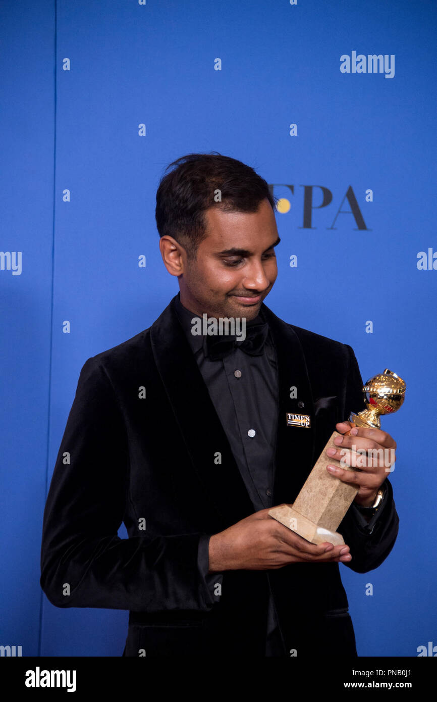 "After winning the category of BEST PERFORMANCE BY AN ACTOR IN A TELEVISION SERIES – COMEDY OR MUSICAL for his role in ""Master of None,"" actor Aziz Ansari poses backstage in the press room with his Golden Globe Award at the 75th Annual Golden Globe Awards at the Beverly Hilton in Beverly Hills, CA on Sunday, January 7, 2018. Stock Photo"
