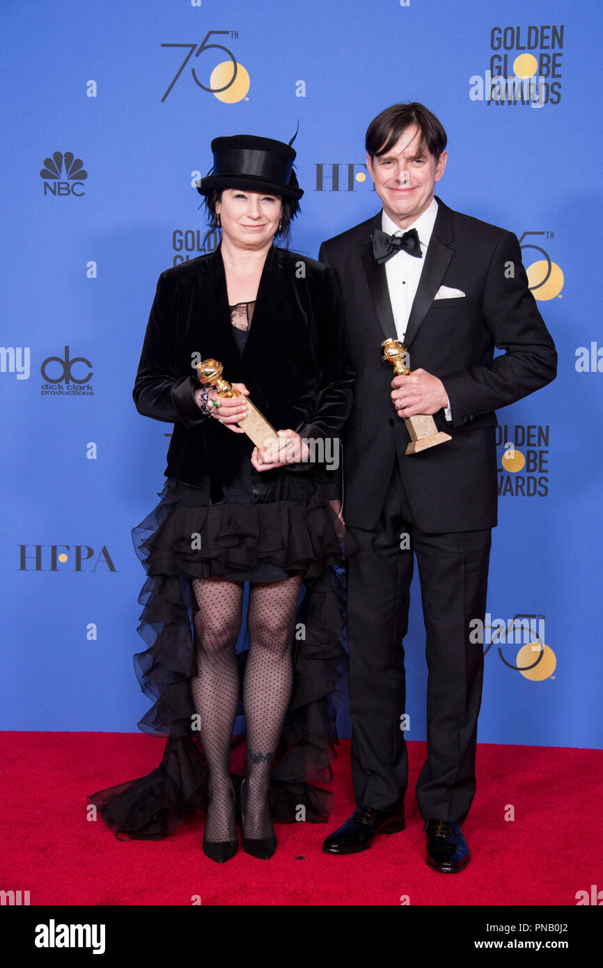 "For BEST TELEVISION SERIES - MUSICAL OR COMEDY, the Golden Globe is awarded to ""The Marvelous Mrs. Maisel"" (AMAZON). Amy Sherman-Palladino and Daniel Palladino pose with the award backstage in the press room at the 75th Annual Golden Globe Awards at the Beverly Hilton in Beverly Hills, CA on Sunday, January 7, 2018. Stock Photo"