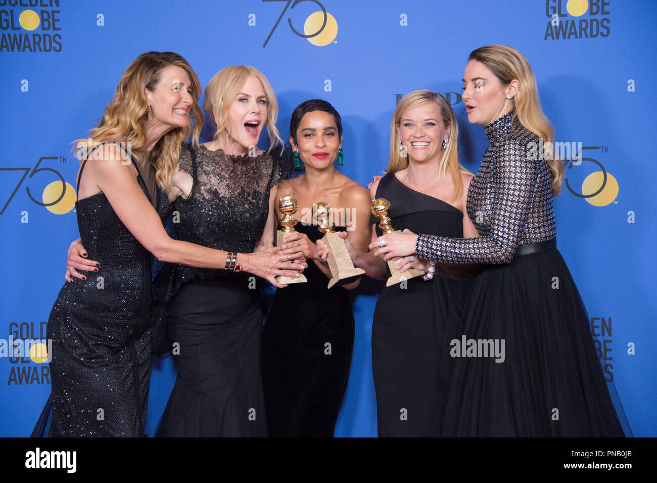 """For Best Television Limited Series or Motion Picture Made for Television, the Golden Globe is awarded to """"Big Little Lies"""" (HBO). Laura Dern, Nicole Kidman, Zoe Kravitz, Reese Witherspoon, and Shailene Woodley pose with the award backstage in the press room at the 75th Annual Golden Globe Awards at the Beverly Hilton in Beverly Hills, CA on Sunday, January 7, 2018. Stock Photo"""