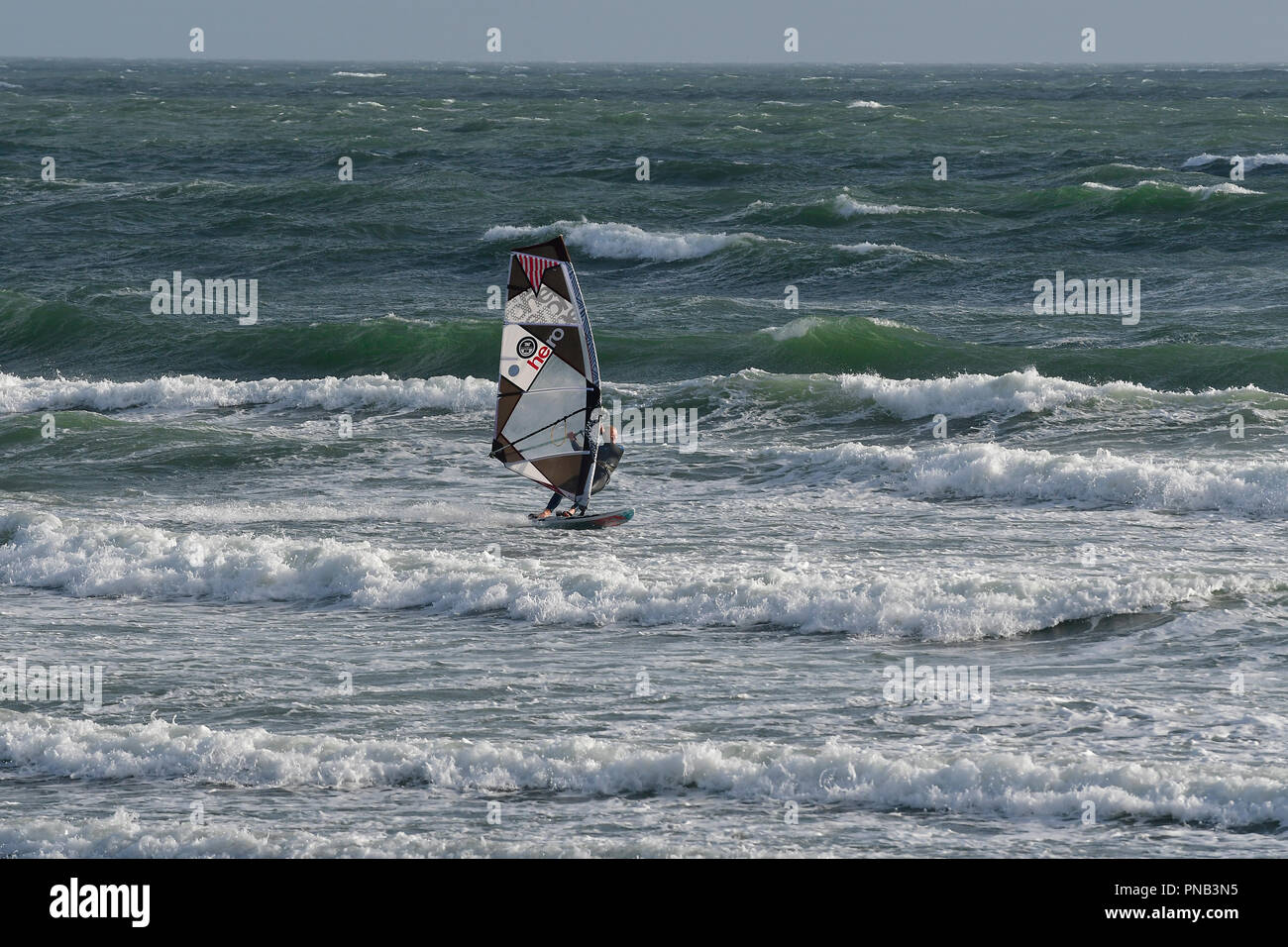 Windsurfers in rough seas on East Wittering Beach, Nr. Chichester, West Sussex, United Kingdom, England Stock Photo