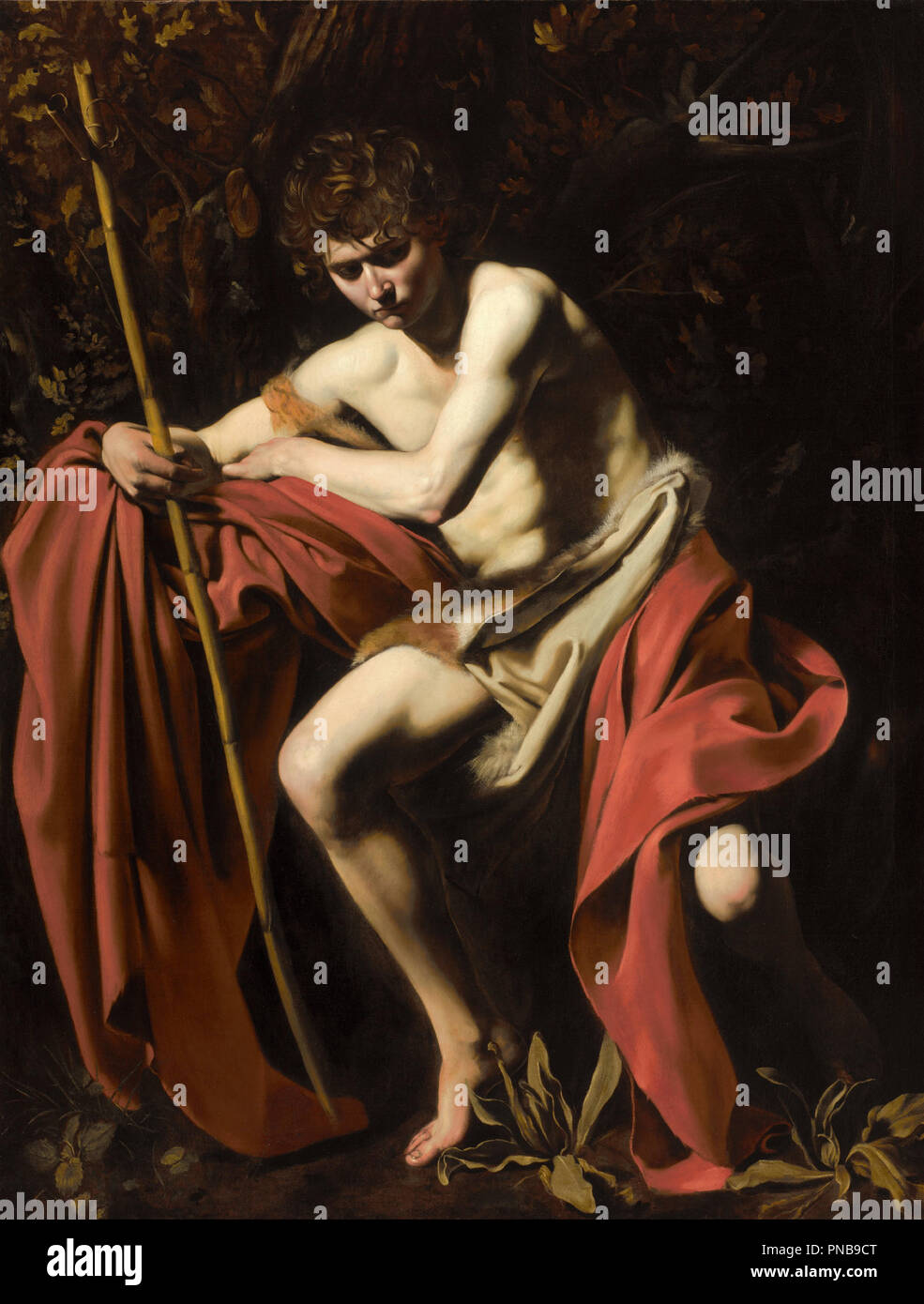 Saint John the Baptist in the Wilderness. Date/Period: Between 1604 and 1605. Painting. Oil on canvas. Height: 172.7 cm (68 in); Width: 132 cm (52 in). Author: CARAVAGGIO. - Stock Image