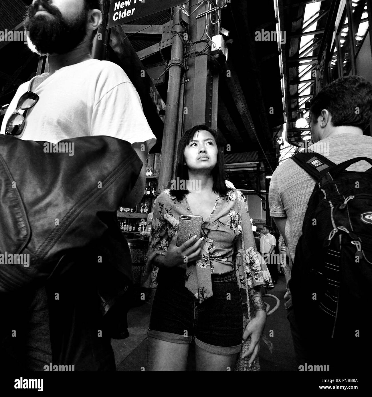 Asian tourist in a crowded Borough Market, Southwark, London, England, UK. Stock Photo