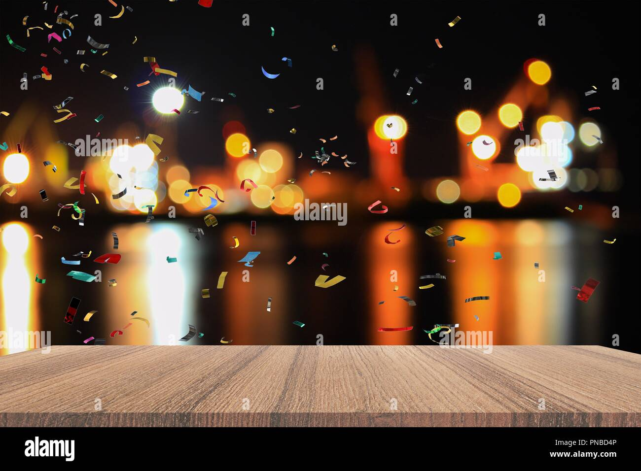 empty wood table and ribbon motion multicolored night light bokeh for christmas new year background with copy space add text