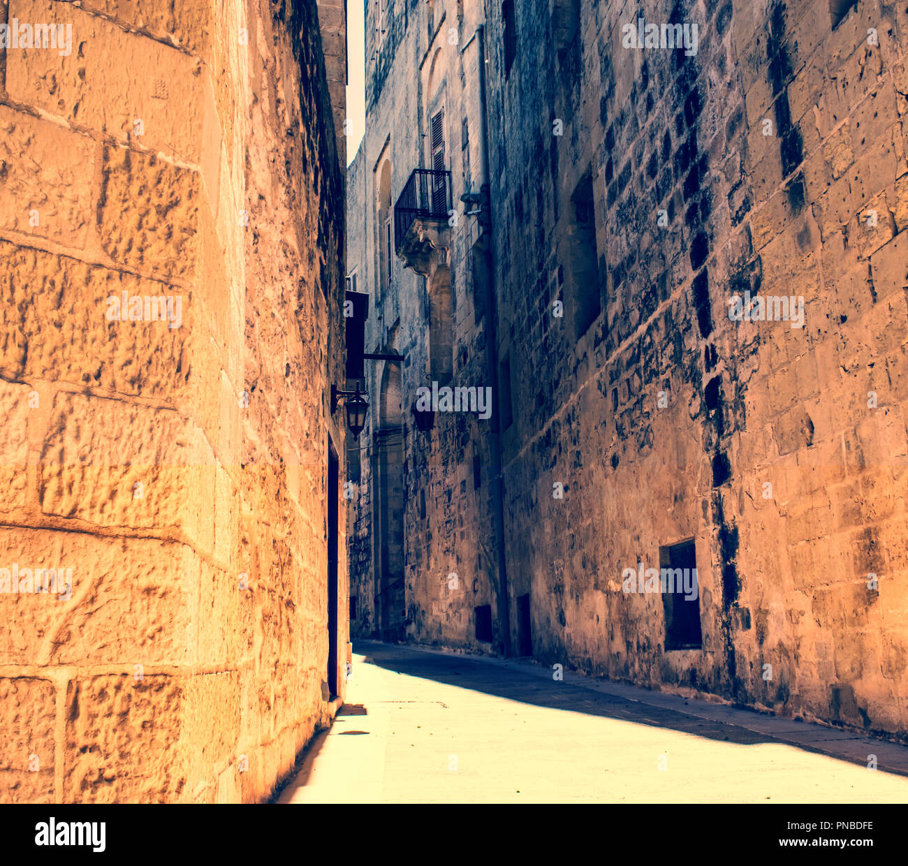A typical and historical narrow road in Mdina, Malta. - Stock Image