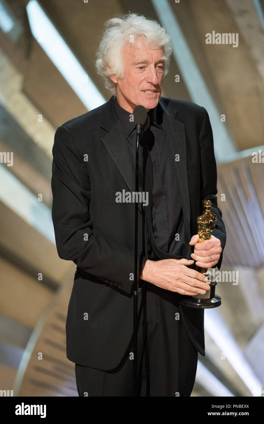 """Roger A. Deakins accepts the Oscar® for achievement in cinematography for work on """"Blade Runner 2049"""" during the live ABC Telecast of The 90th Oscars® at the Dolby® Theatre in Hollywood, CA on Sunday, March 4, 2018.  File Reference # 33546_593PLX  For Editorial Use Only -  All Rights Reserved - Stock Image"""