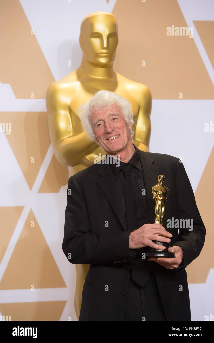 """Roger A. Deakins poses backstage with the Oscar® for achievement in cinematography for work on """"Blade Runner 2049"""" during the live ABC Telecast of The 90th Oscars® at the Dolby® Theatre in Hollywood, CA on Sunday, March 4, 2018.  File Reference # 33546_656PLX  For Editorial Use Only -  All Rights Reserved - Stock Image"""