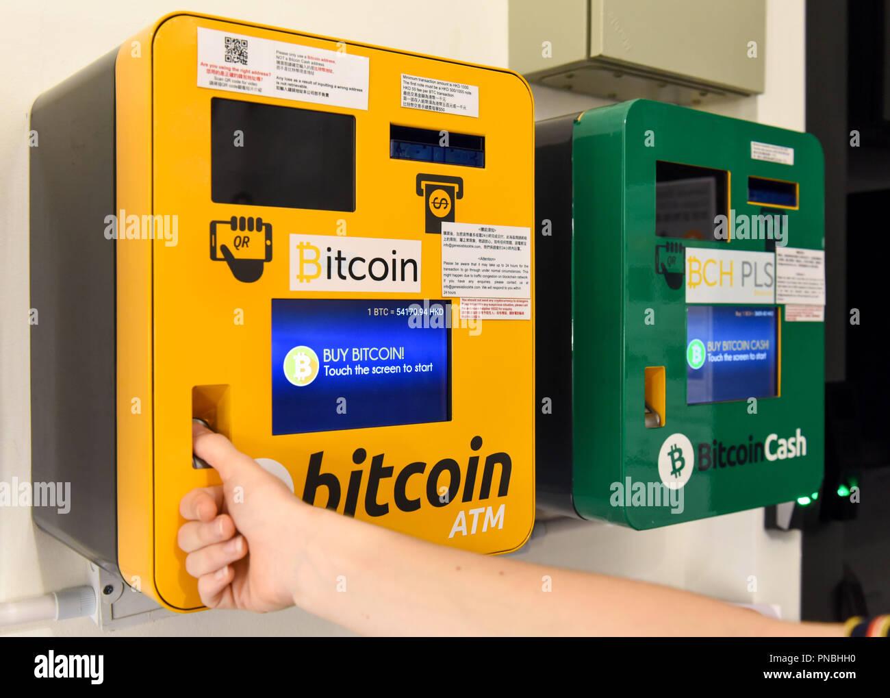 HONG KONG,HONG KONG SAR,CHINA: SEPTEMBER 20th, 2018.A woman uses the Bitcoin and Ethereum ATM installed at the Genesis Block Wan Chai. Genesis Block i - Stock Image