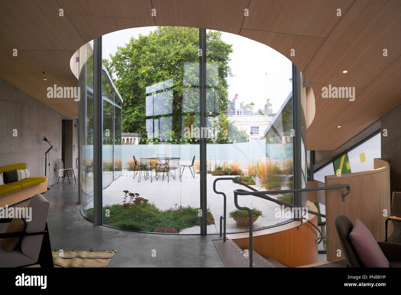 View looking out onto the rooftop garden from inside Maggies Centre at St Barts Hospital in Smithfield City of London UK  KATHY DEWITT Stock Photo