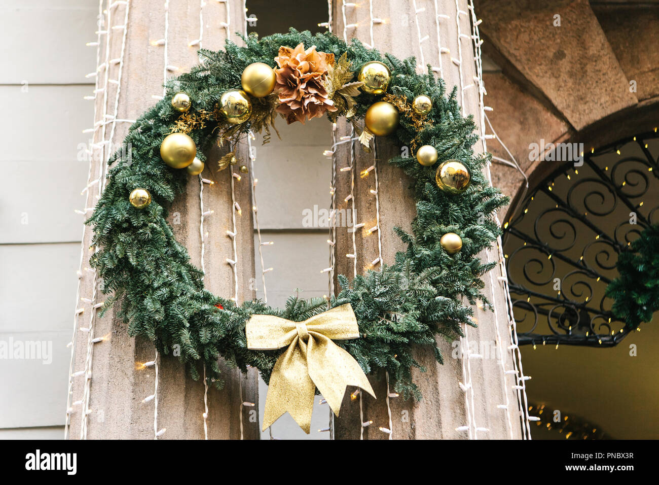 christmas decorations on the street in prague in the czech republic a traditional christmas wreath decorates the columns of the building