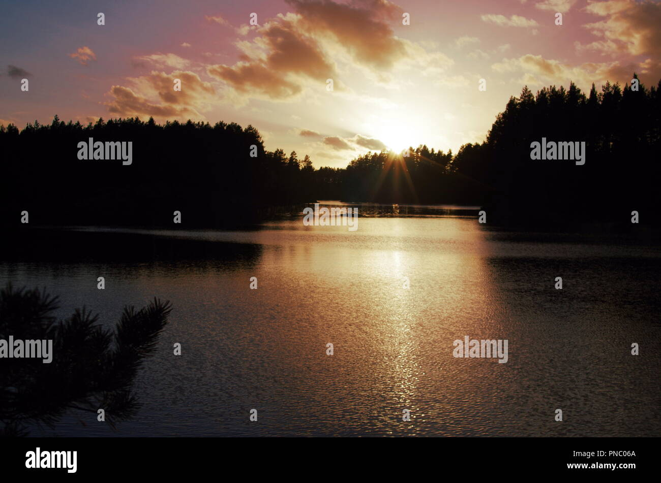 Beautiful autumn sunset over a lake in Dalarna - Stock Image