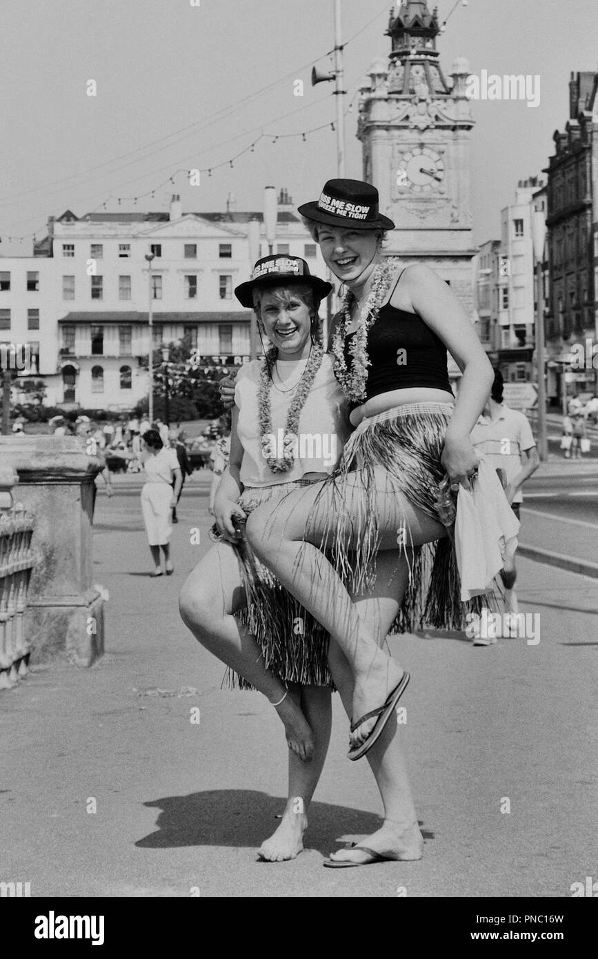 Two young women in fancy dress, Margate, Kent, England, UK. Circa 1980's - Stock Image