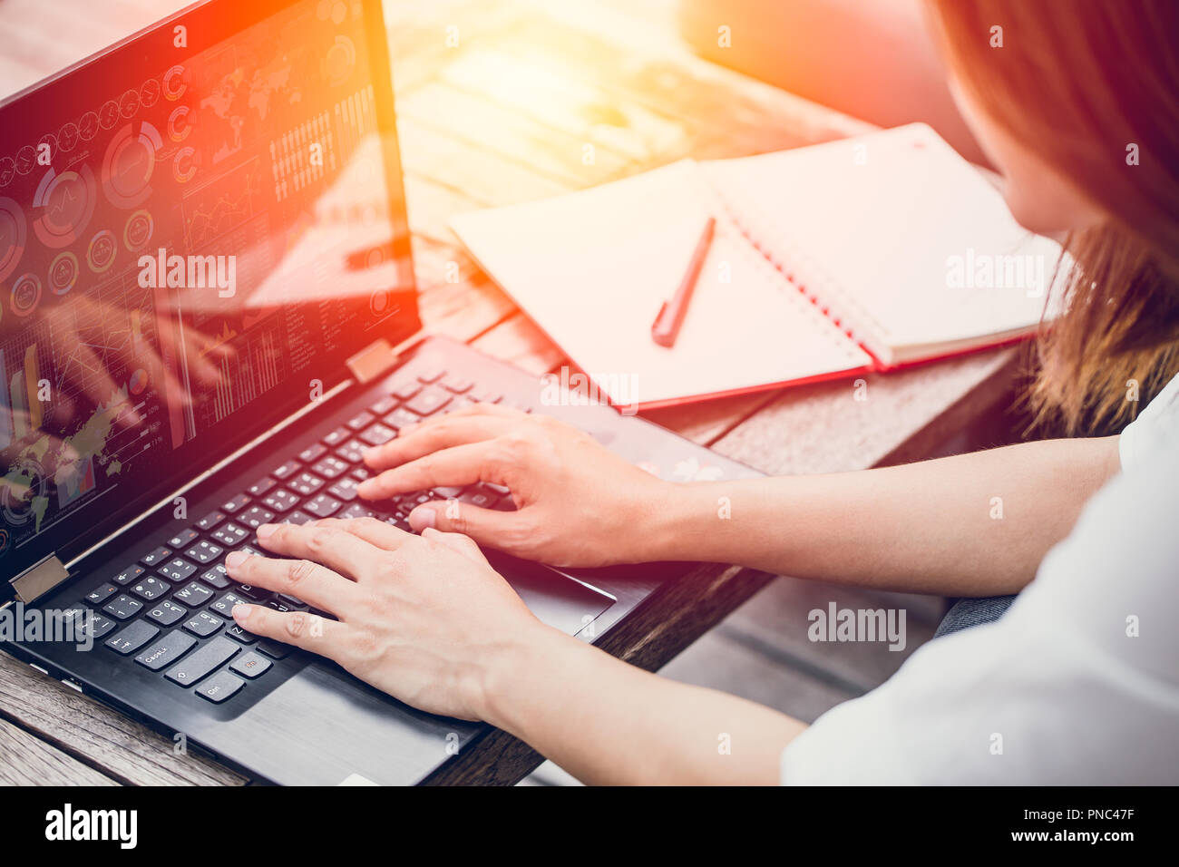Asian Business woman work typing on laptop at coffee cafe workplace, Holiday working startup concept. Stock Photo