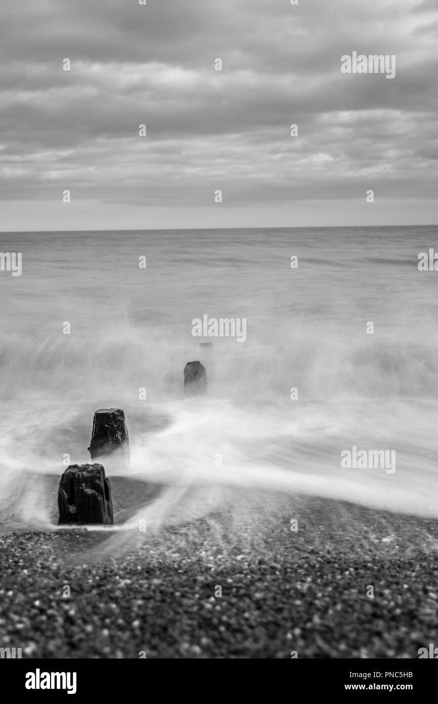 Minimalistic long exposure looking out to sea at Bawdsey, Suffolk, UK. Frame contains a lot of empty space - Stock Image