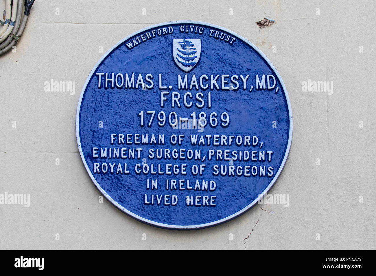 Waterford, Republic of Ireland - August 14th 2018: A blue plaque in the historic city of Waterford in Ireland, marking where Thomas L. Mackesy - famou - Stock Image