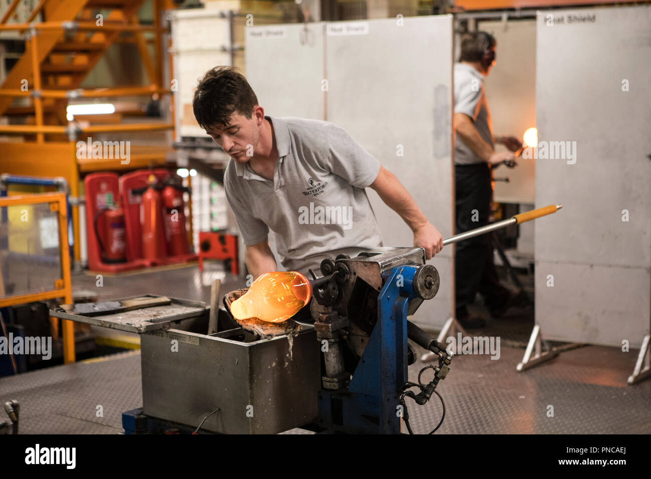 Waterford, Republic of Ireland - August 15th 2018: A craftsman in the Blowing Department in the Waterford Crystal factory, in the city of Waterford, R - Stock Image