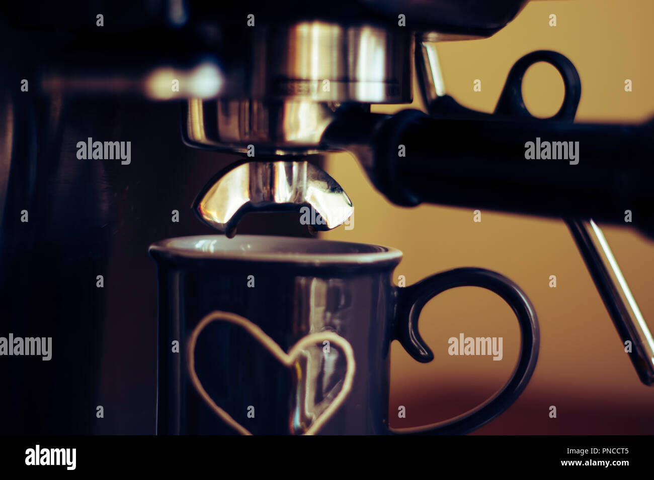6d97af7879c Espresso machine making coffee in a grey cup with white heart Stock ...