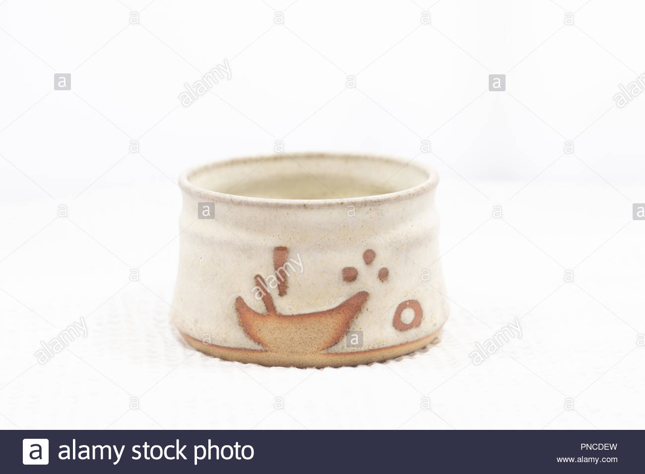 An empty earthenware bowl, from horizontal perspective - Stock Image