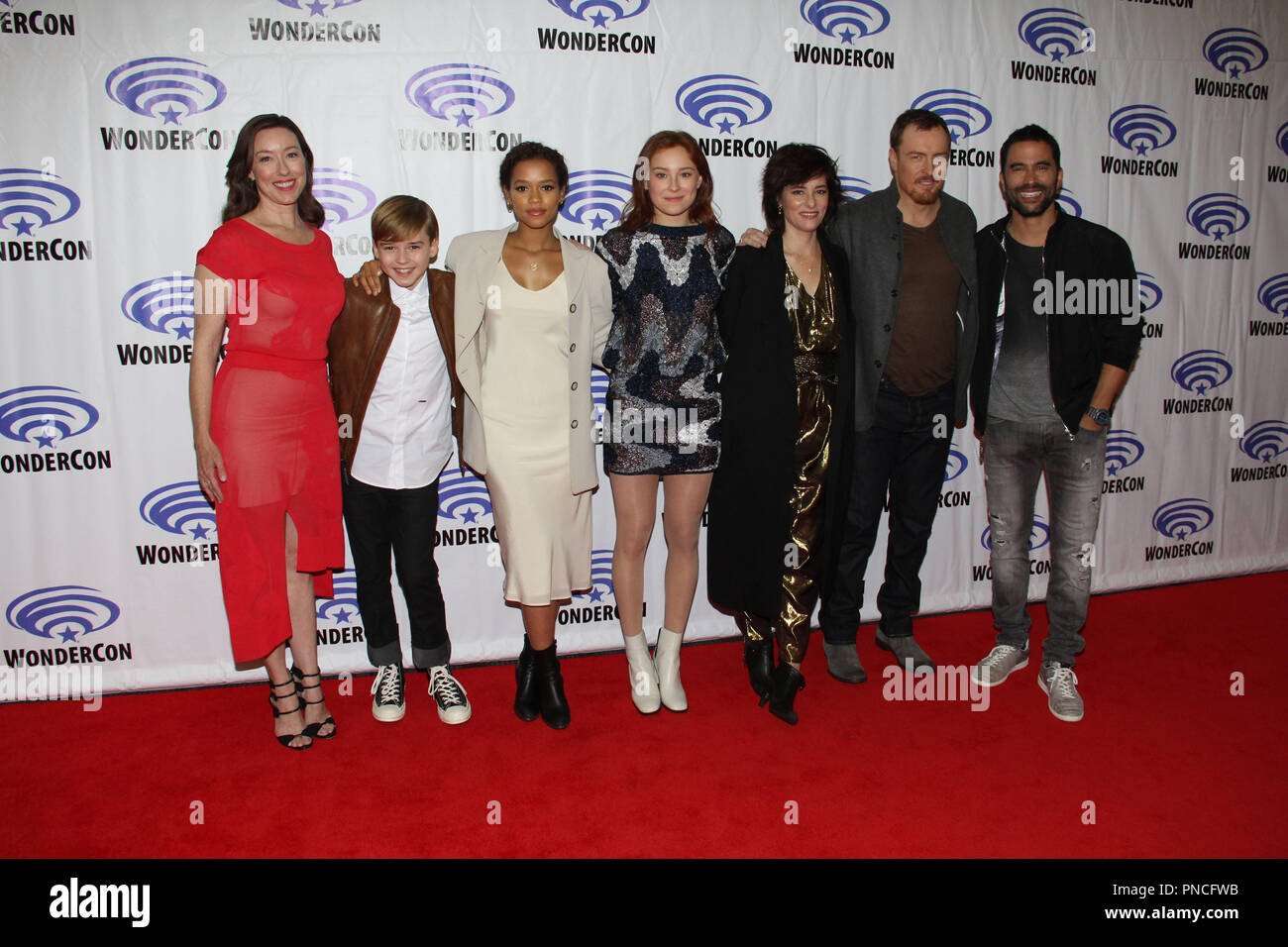 Molly Parker, Max Jenkins, Taylor Russell, Mina Sundwall, Parker Posey, Toby Stephens and Ignacio Serricchio promoting Netflix Original Series 'Lost In Space' at Day 2 of WonderCon Anaheim 2018. Held at the Anaheim Convention Center in Anaheim, CA. March 23 2018. Photo by: Richard Chavez / PictureLux - Stock Image