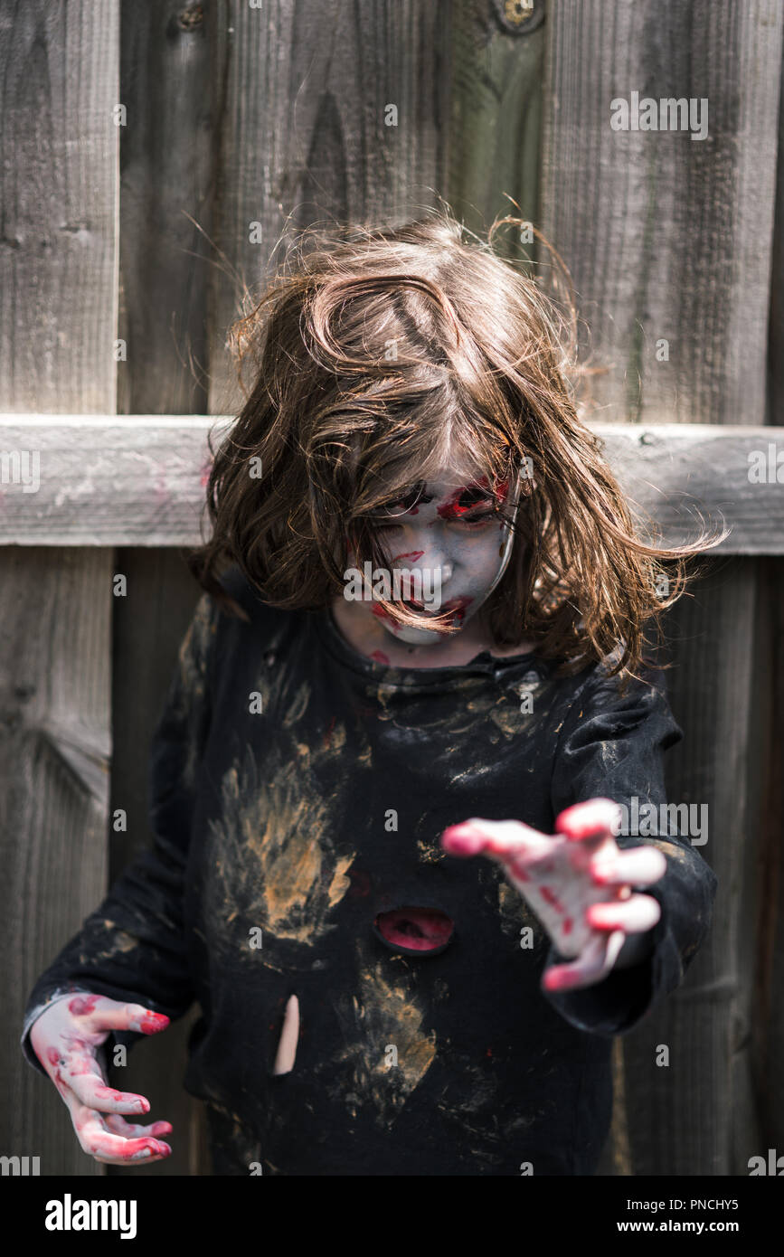 young girl zombie looking scary and menacing - Stock Image
