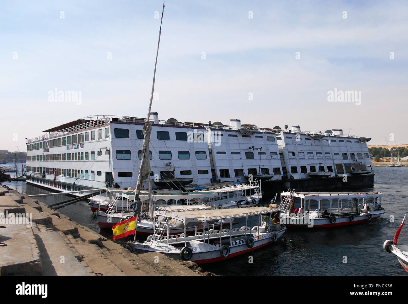 Three of the many smaller cruise ships, that cruise up and down the Nile, are seen tied up here on the quayside on the River Nile in Egypt. - Stock Image