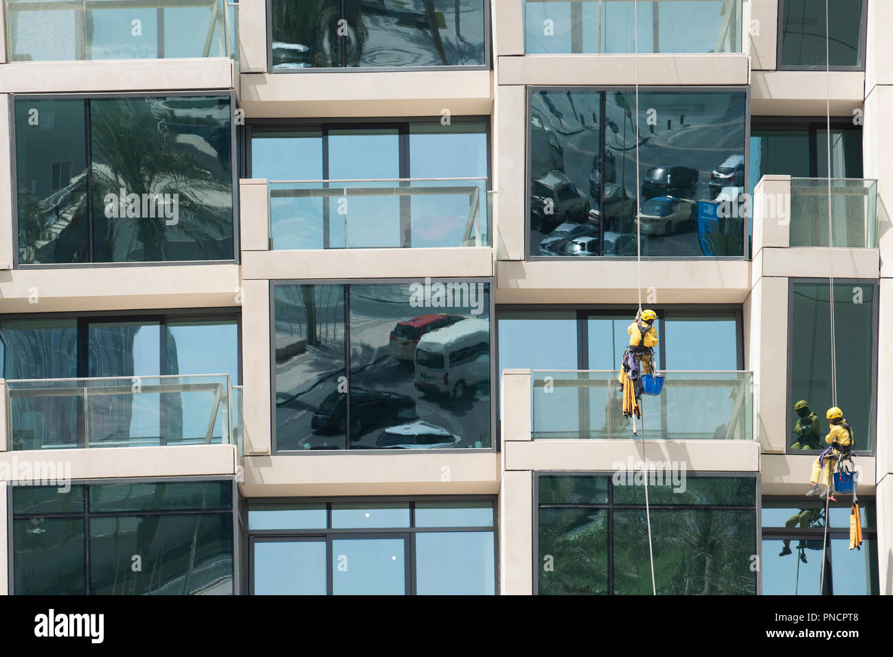 Detail of windows and balconies and window cleaners on new high rise apartment building in Downtown Dubai, UAE, United Arab Emirates. - Stock Image