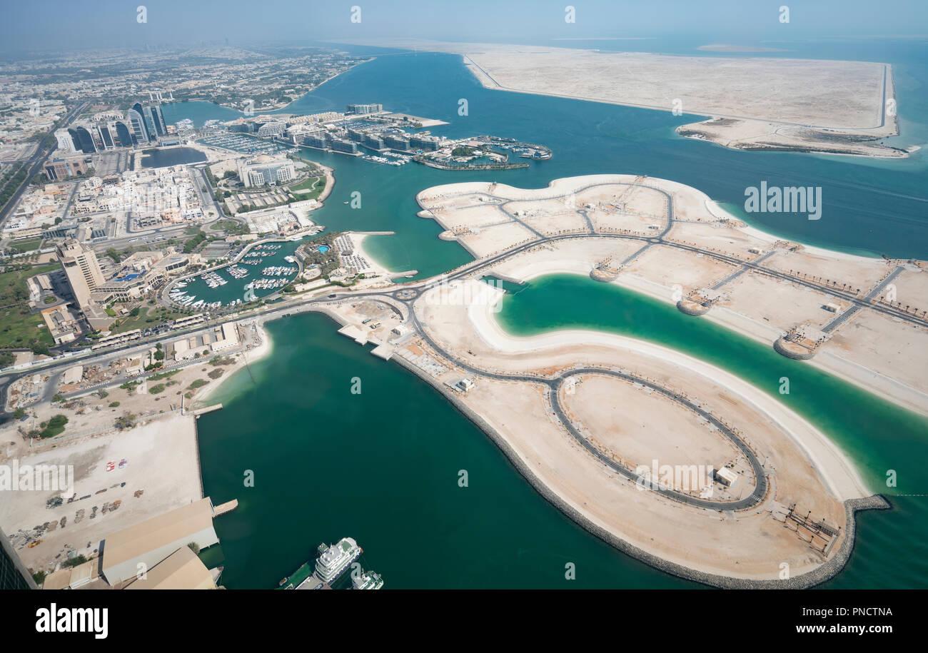 Land reclamation for property development in Abu Dhabi, UAE, United Arab Emirates - Stock Image