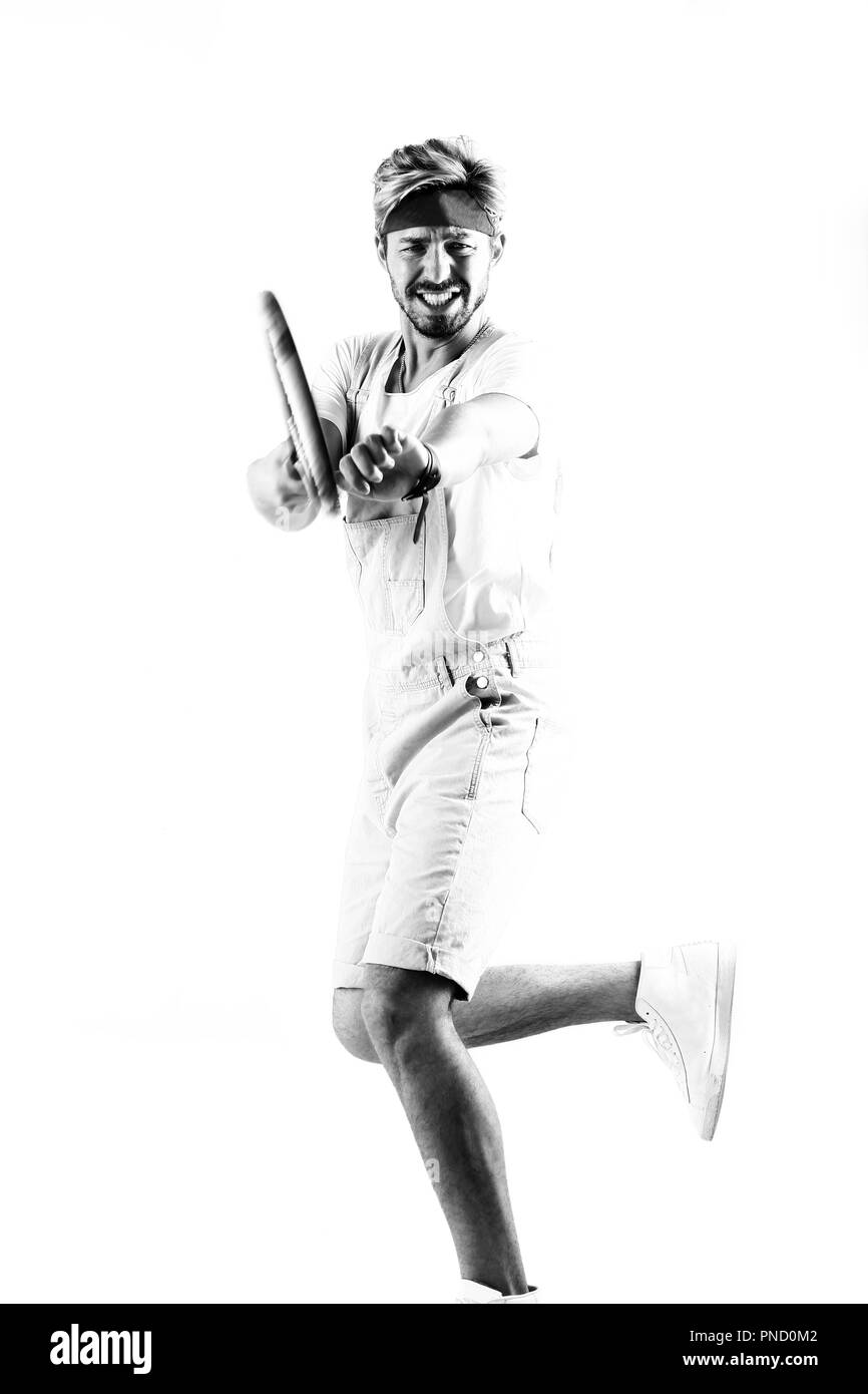 Handsome young sportsman holding racket isolated on white - Stock Image