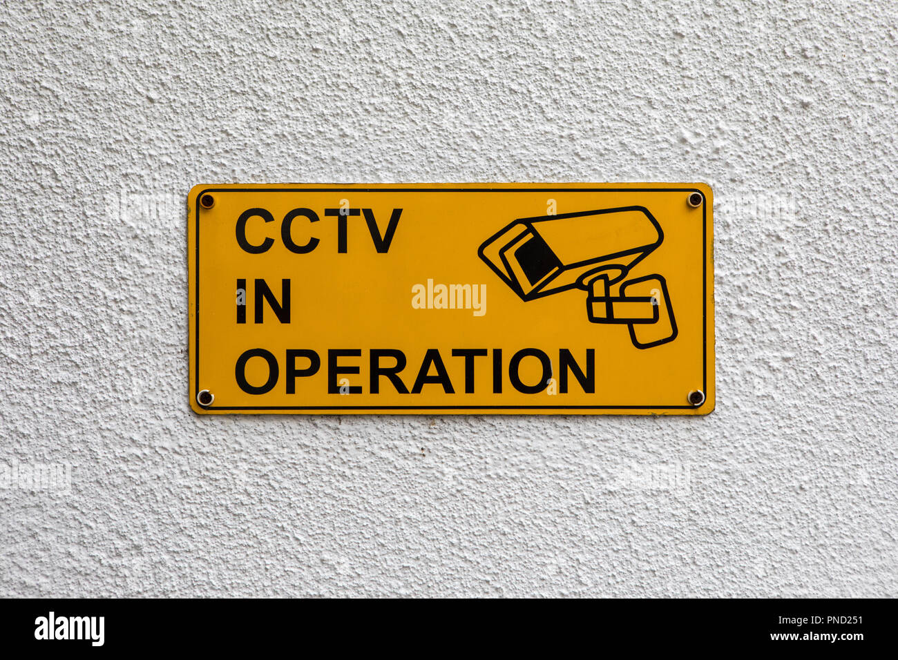 A sign cautioning passersby that CCTV is in operation. - Stock Image