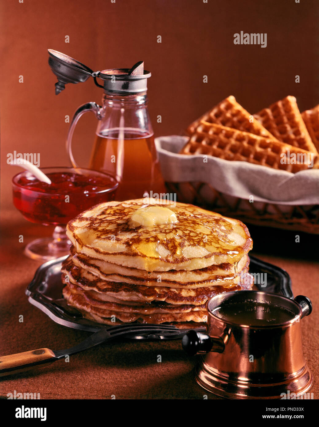 1950s STACK OF PANCAKES MELTING BUTTER PITCHER MAPLE SYRUP BASKET OF WAFFLES HONEY JAM PRESESRVES - kf21246 PHT001 HARS OLD FASHIONED - Stock Image