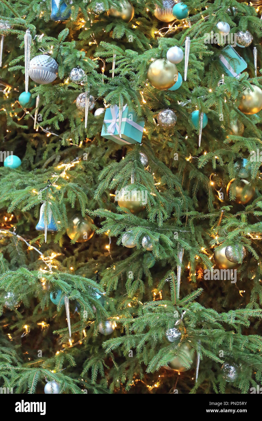 Icicles For Christmas Trees.Beautiful Christmas Tree With Icicles And Gifts Stock Photo