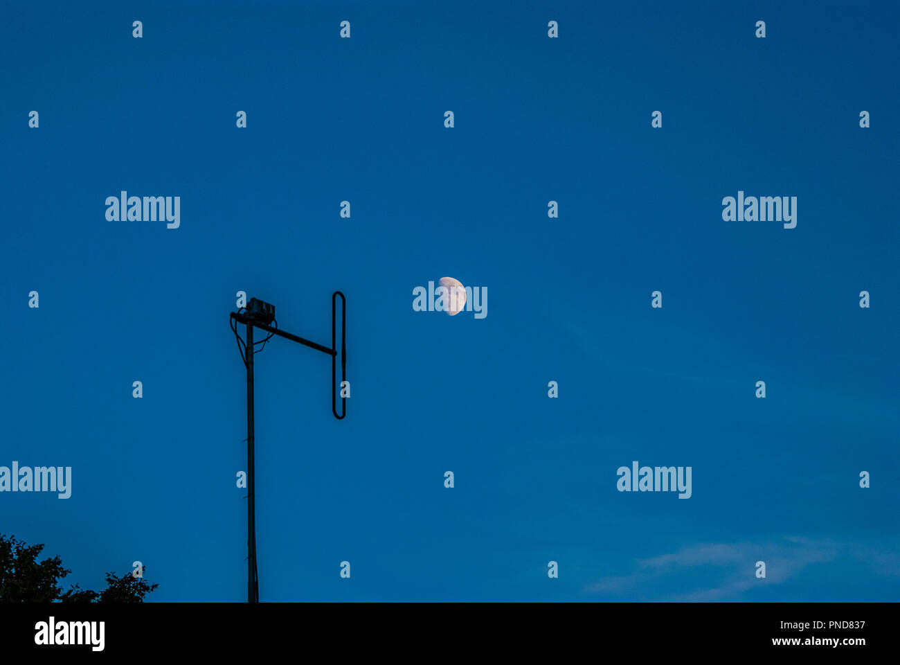 The old television antenna is aimed at the moon - Stock Image