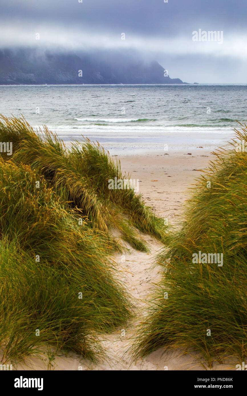 A view through the dunes to Keel Beach on Achill Island in County Mayo, Ireland. - Stock Image