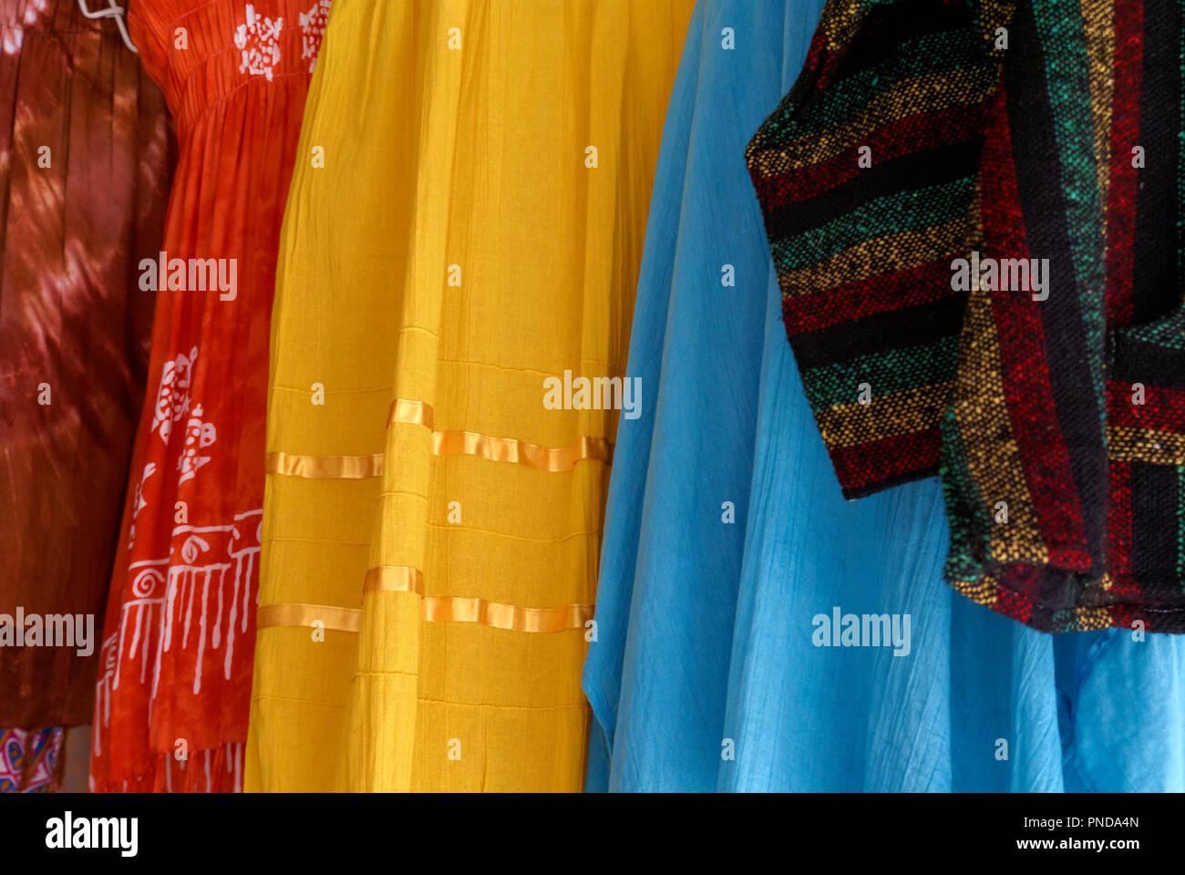 Colorful women's dresses and skirts for sale in in the Mercado Pino Suarez Market,  Mazatlan, Sinaloa, Mexico - Stock Image
