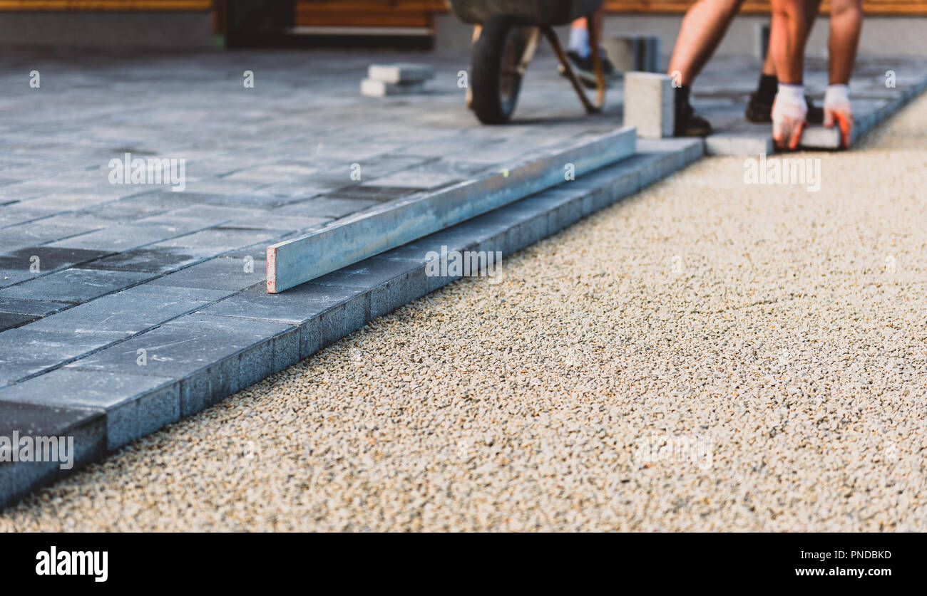 Laying Gray Concrete Paving Slabs In House Courtyard Driveway Patio.  Professional Workers Bricklayers Are Installing New Tiles Or Slabs For  Driveway,