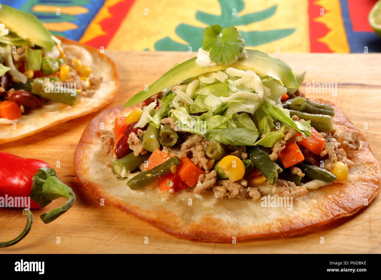 Crunchy Beef Tostada Stack Typical Mexican Food Made With Crispy Fried Corn Tortillas With Guacamole Cheese Sour Cream And Salsa Stock Photo Alamy