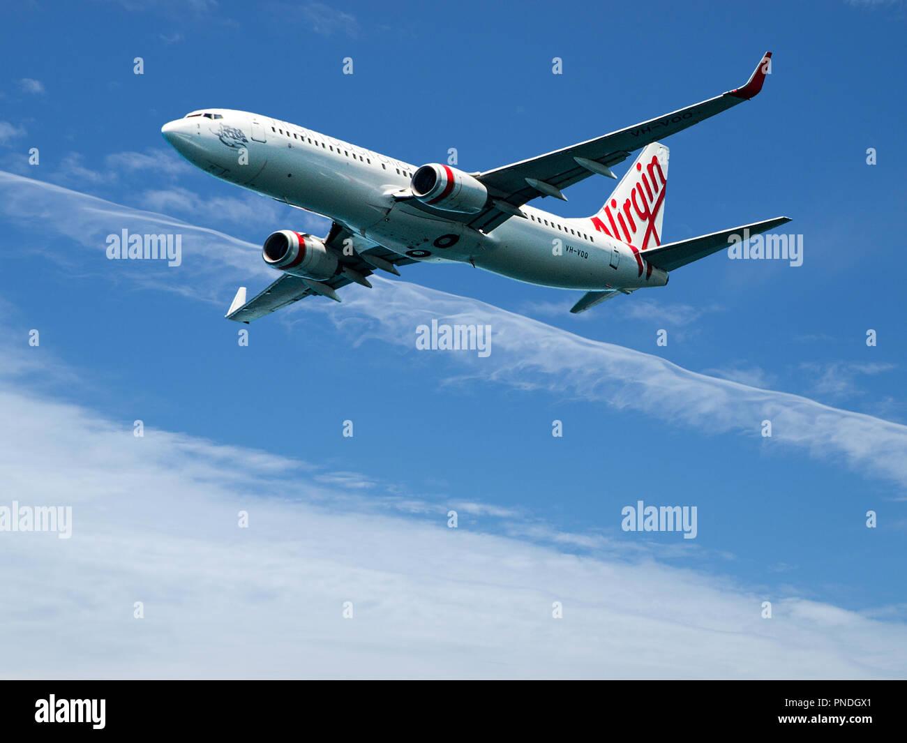 Sydney, New South Wales, Australia - October 4. 2014: Virgin Australia commercial passenger jet aircraft in flight closeup departing Sydney - Stock Image
