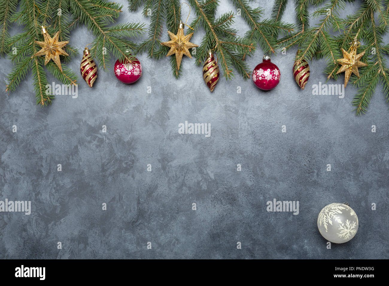 Holiday Frame Of Christmas Decorations On Blue Dark Stucco