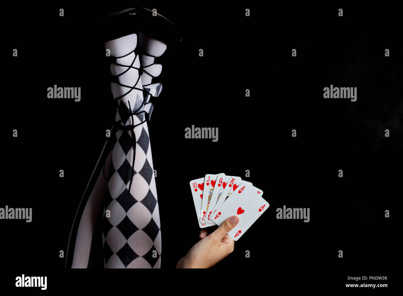 girl with tights holding play cards - royal flush - Stock Image