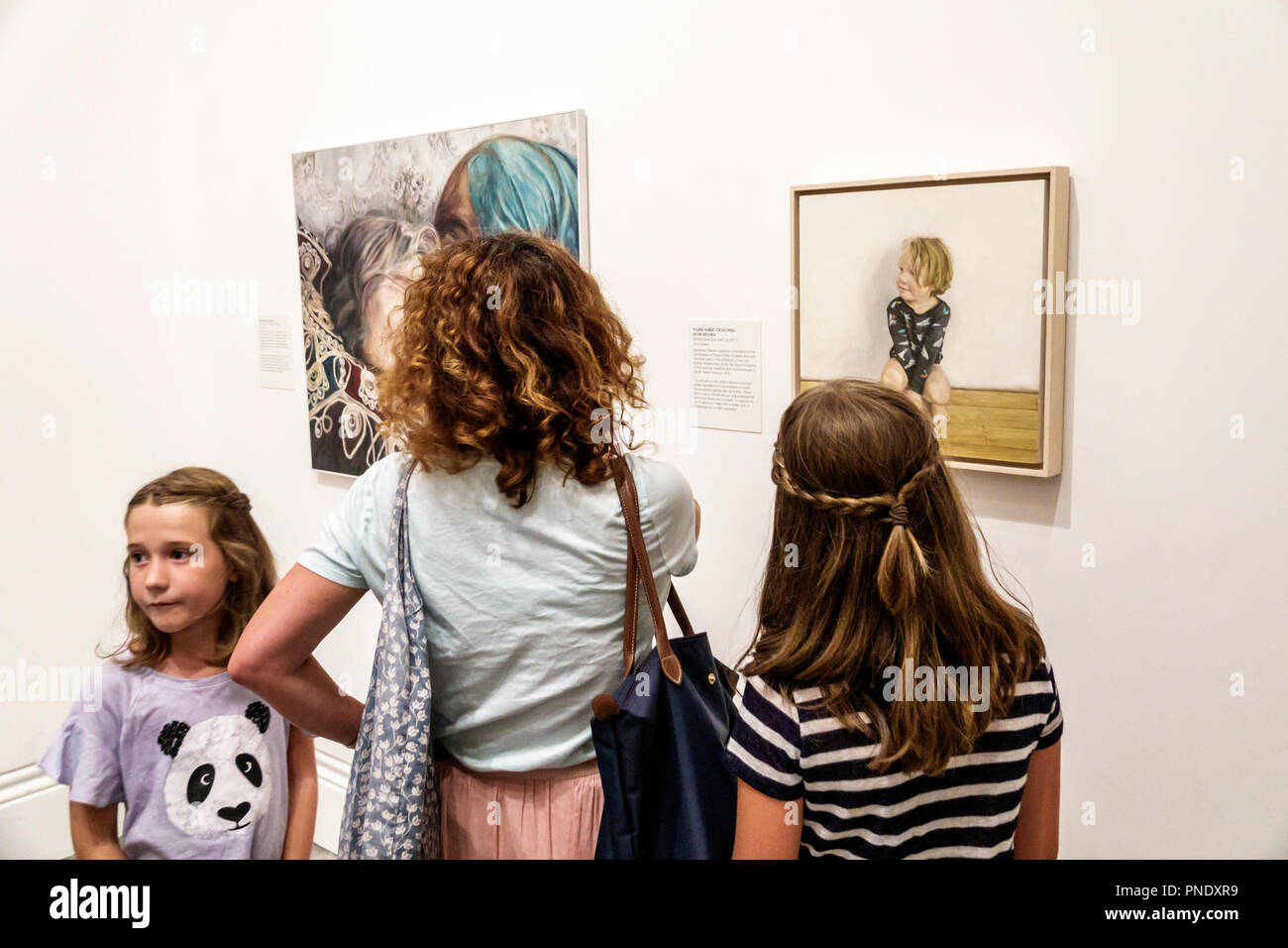 London England Great Britain United Kingdom Covent Garden National PortraitGallery art museum interior BP Portrait Award exhibition painting Annalisa Avancini Samantha Fellows Found Albert Crouching in the Kitchen woman girls mother daughters sisters family - Stock Image