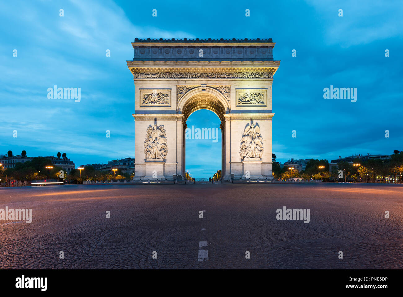 Arc de Triomphe and Champs Elysees, Landmarks in center of Paris, at night. Paris, France - Stock Image
