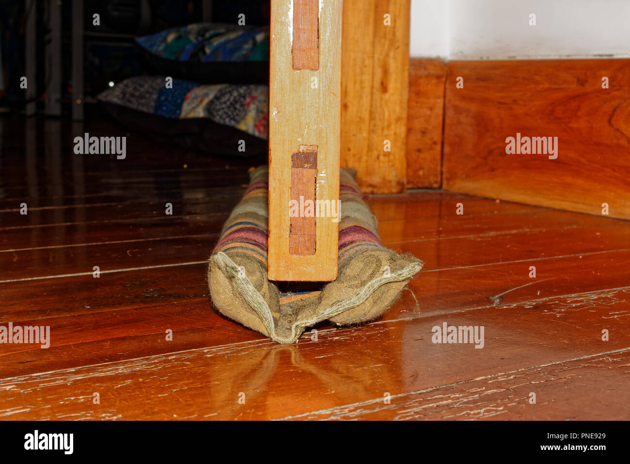 You don't have to move your draught excluder with a double one, it slides with the door when it is opened and clsed. - Stock Image