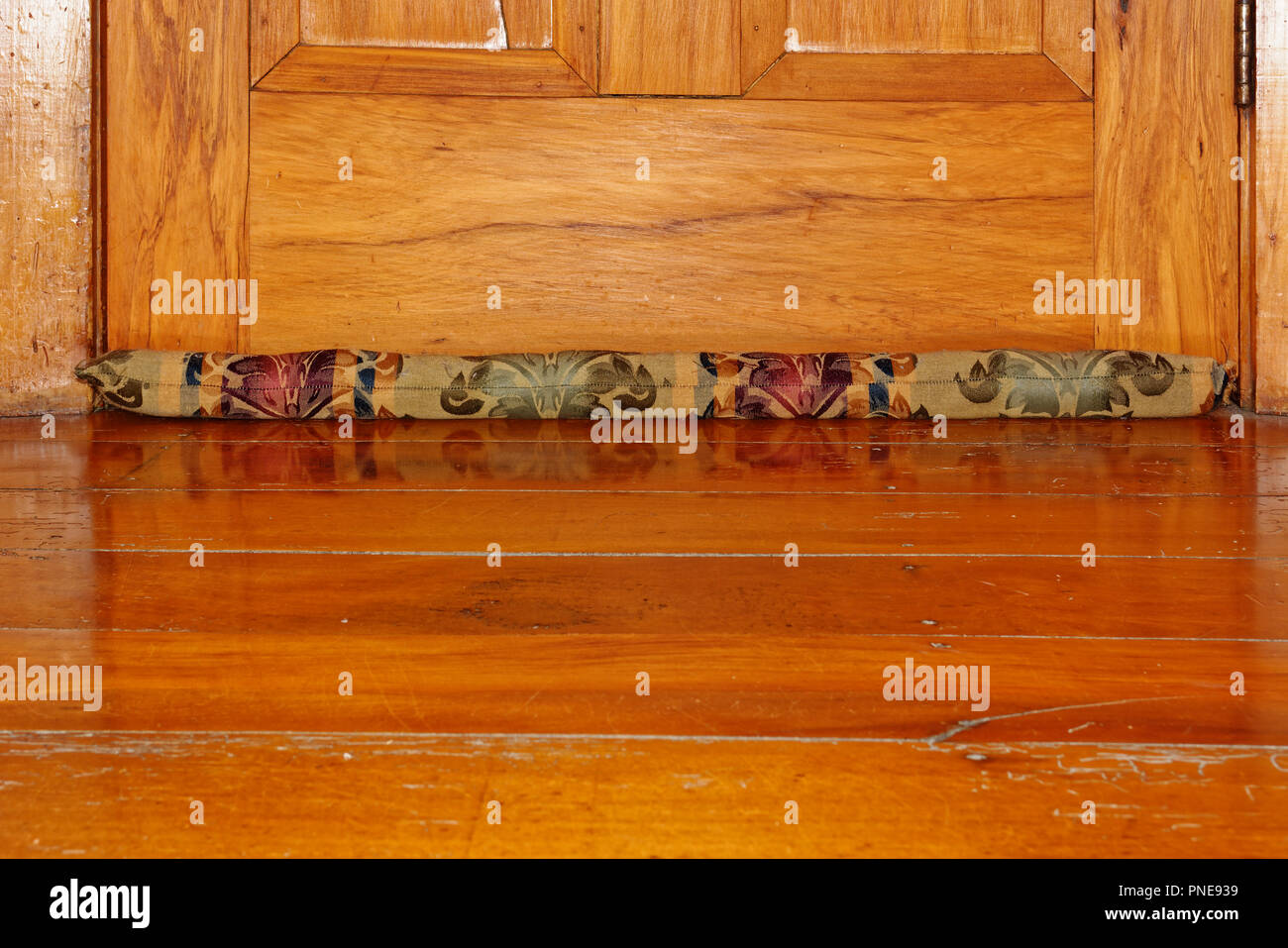 Get crafty, make a draught excluder for winter warmth - Stock Image