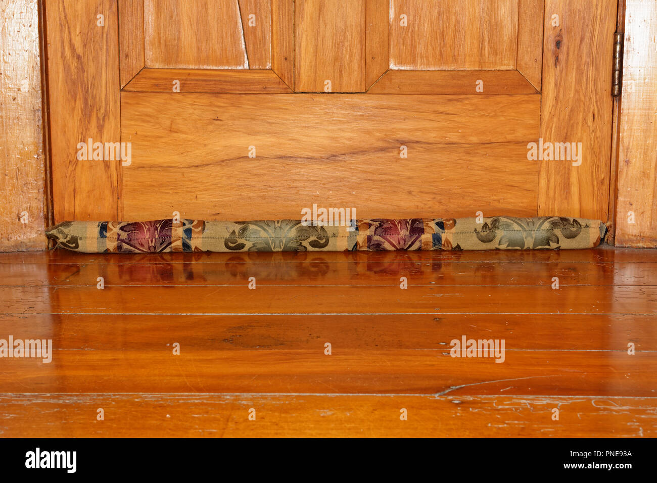 Draught excluders stop chilly draughts stealing your warmth - Stock Image
