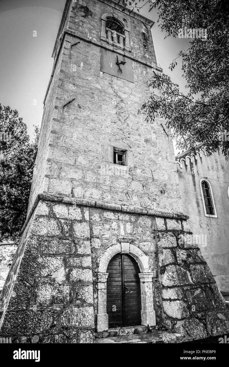 The rustic old church of the Holy Trinity at Punat on the Croatian island of Krk in the Adriatic Sea - Stock Image
