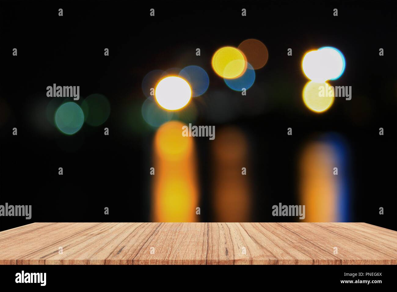 empty wood table and night light bokeh for christmas new year background with copy space add text