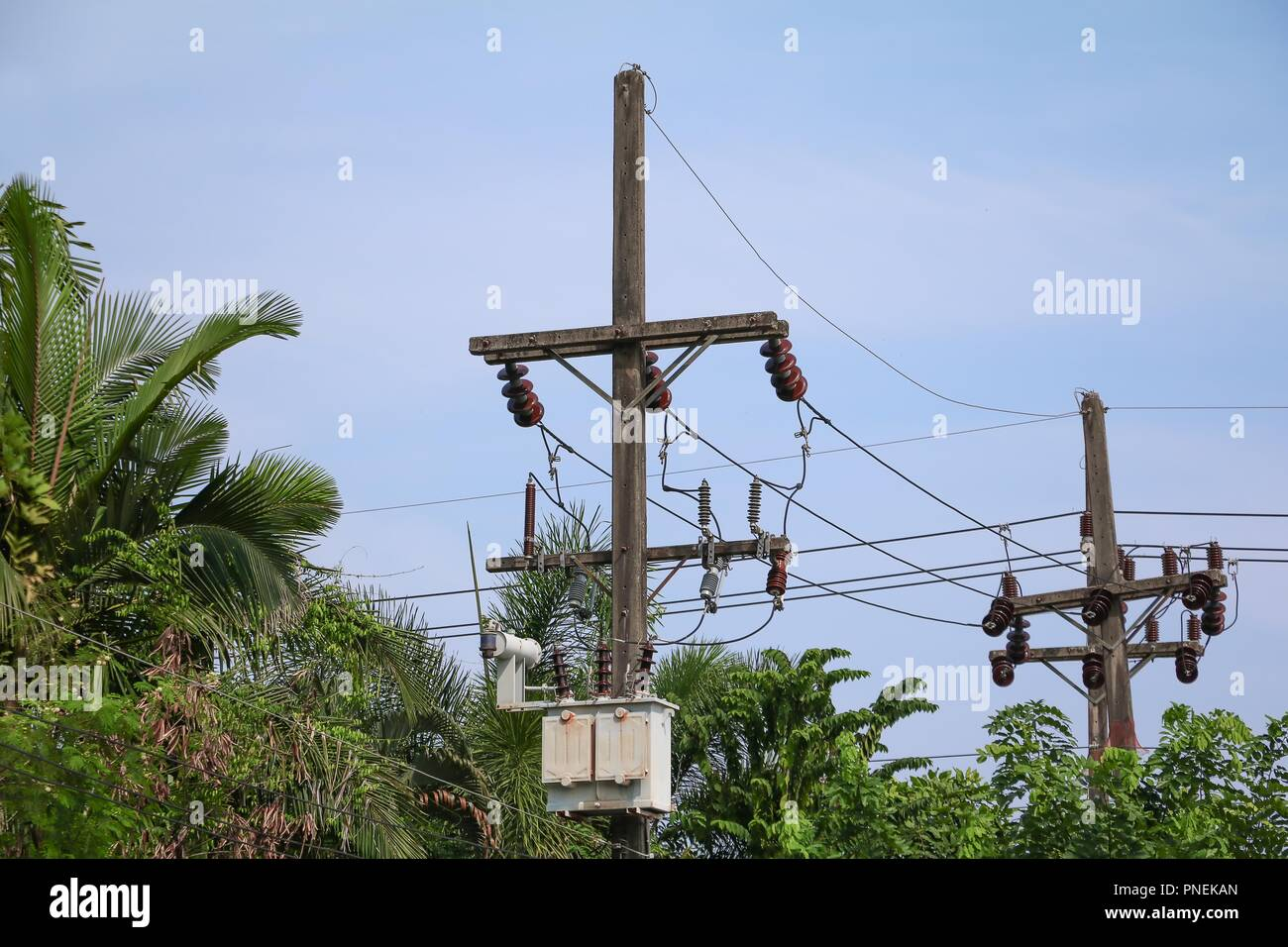 electricity post high voltage and cable line on Sky Blue background. - Stock Image