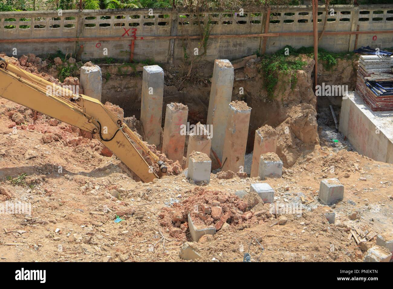 excavators work dig a hole in construction work industry at building site - Stock Image
